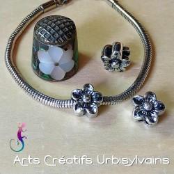 Perle fleur en métal...