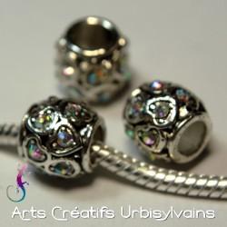 Perle en métal argenté avec...